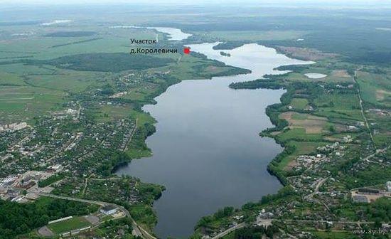 Продам земельный участок 25 соток в деревне на берегу озера...