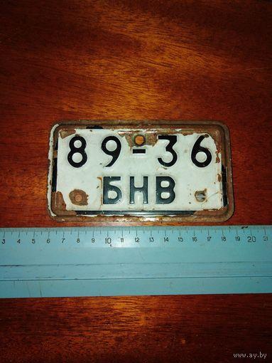 Веломопедный номерок с оригинальным креплением. Буквы выдалены.